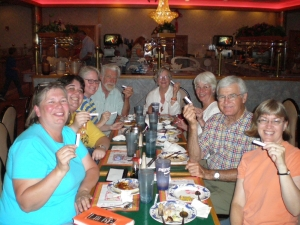 A book club with their fortunes at a Powerball restaurant in Lawrence, Kansas